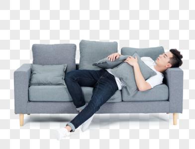 躺在沙发上休息睡觉的青年男性图片