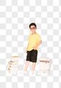 站在书本旁的快乐小男孩图片