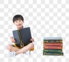 盘腿抱着书的小孩图片