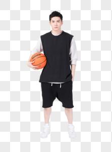 拿着篮球打篮球的年轻男生图片