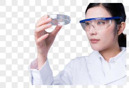 科学家手拿器皿做研究图片图片
