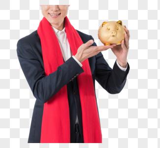 商务男性手拿理财金猪图片