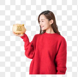银行 年轻女性手捧金猪储蓄罐图片