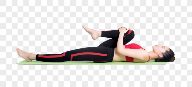 年轻女性在瑜伽垫上做瑜伽动作图片图片