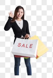 打折促销疯狂购物的年轻美女图片图片