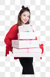 抱着礼盒的年轻美女图片图片
