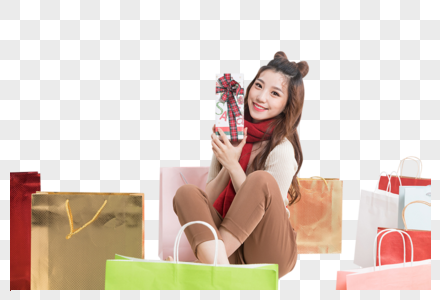 购物狂欢拿着礼盒的美女图片图片