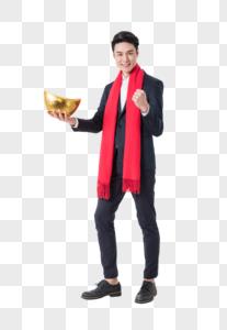 成功商务人士手拿金元宝图片图片