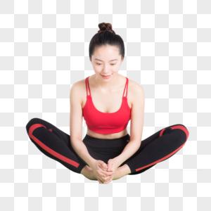 瑜伽垫上做瑜伽动作的年轻女性图片图片