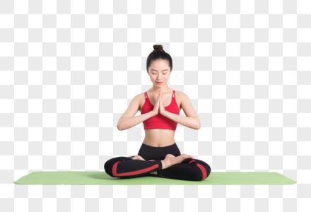 年轻女性做双手合十的瑜伽动作图片图片