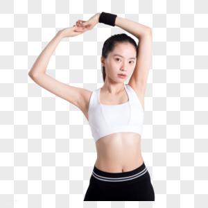 年轻女性健身动作拍摄图片