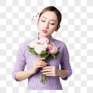 旗袍美女手持鲜花图片