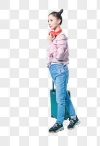 青年女性拖着拉杆箱动作图片