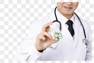 医生手持药物底图图片
