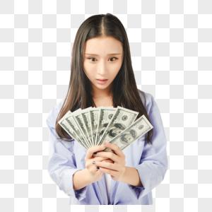 年轻女孩手拿钞票惊讶表情图片