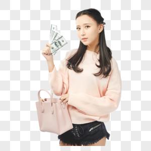 年轻女孩挎包购物动作图片