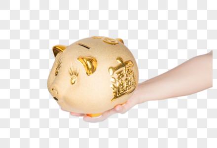 手拿存钱罐图片