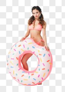 美女穿粉色比基尼的可爱女生拿着甜甜圈泳圈图片