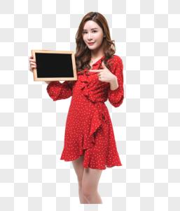 时尚年轻女性小黑板展示动作图片