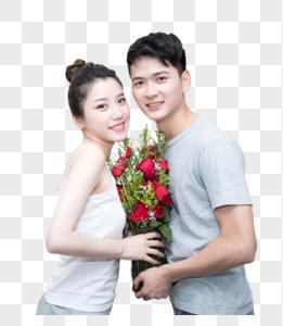 情侣捧着玫瑰花甜蜜合影图片