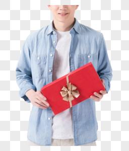 年轻帅气男士手拿礼物盒送礼展示图片