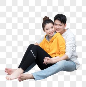开心幸福地坐在地上拥抱的情侣图片