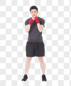 健身男性自由搏击出拳动作图片