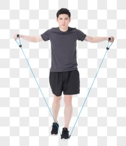 青年男子使用阻力带健身塑身图片