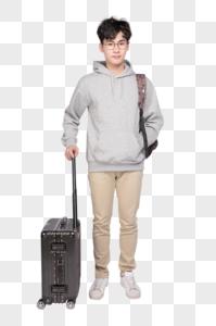 拉着行李箱背着书包的男生图片