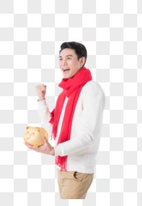 年轻男性手拿金猪投资理财概念图片