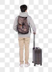 拉着行李箱背着书包的男生背影图片