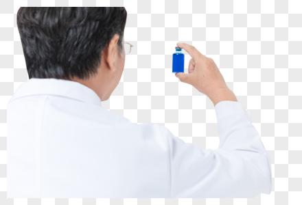 老医生拿药瓶图片