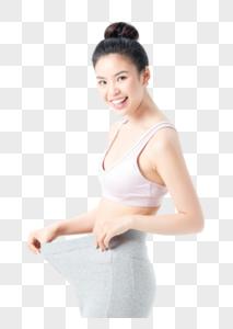 运动美女减肥成功宽松裤子图片