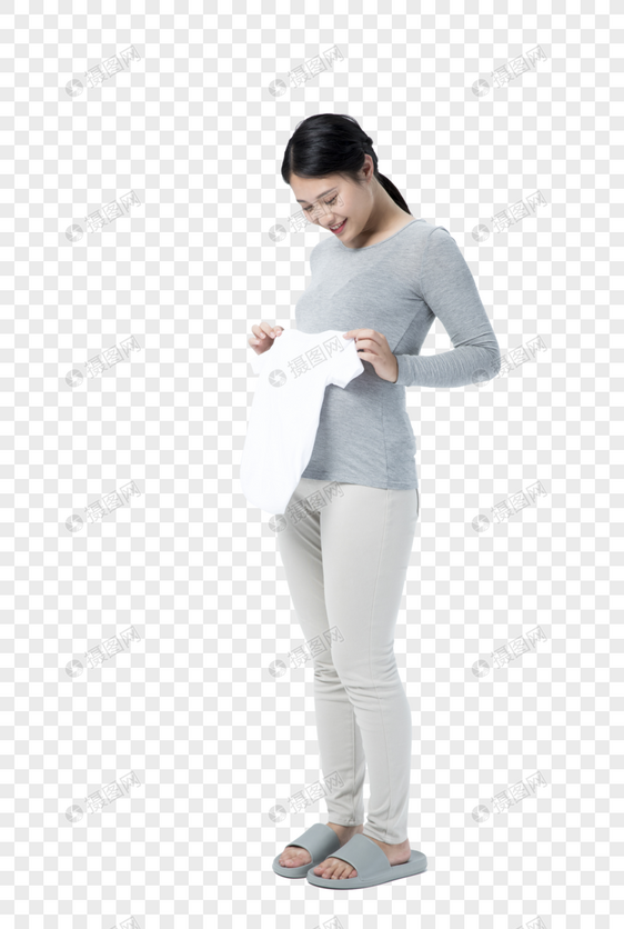孕妇拿着宝宝衣物图片