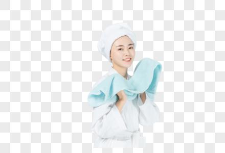 拿蓝色毛巾的美女图片