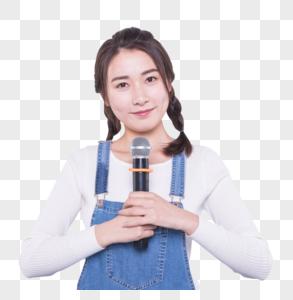 拿着话筒的女大学生图片