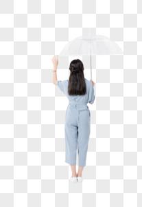 年轻美女撑伞背影图片