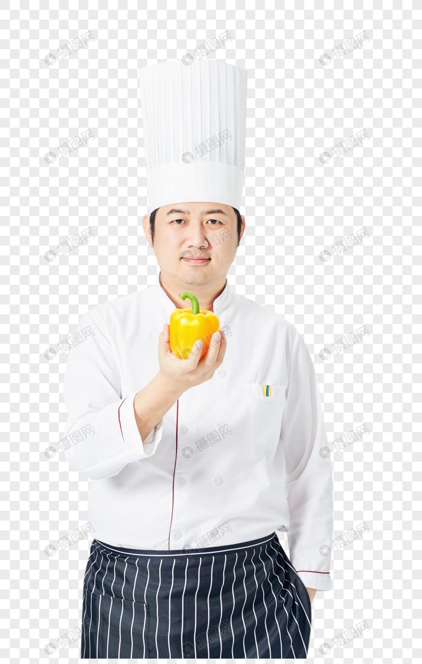 男性厨师拿菜椒图片