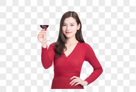 时尚美女在品红酒图片