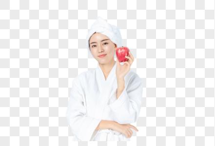 穿浴袍女生手拿苹果图片