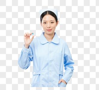 美女护士手拿药图片
