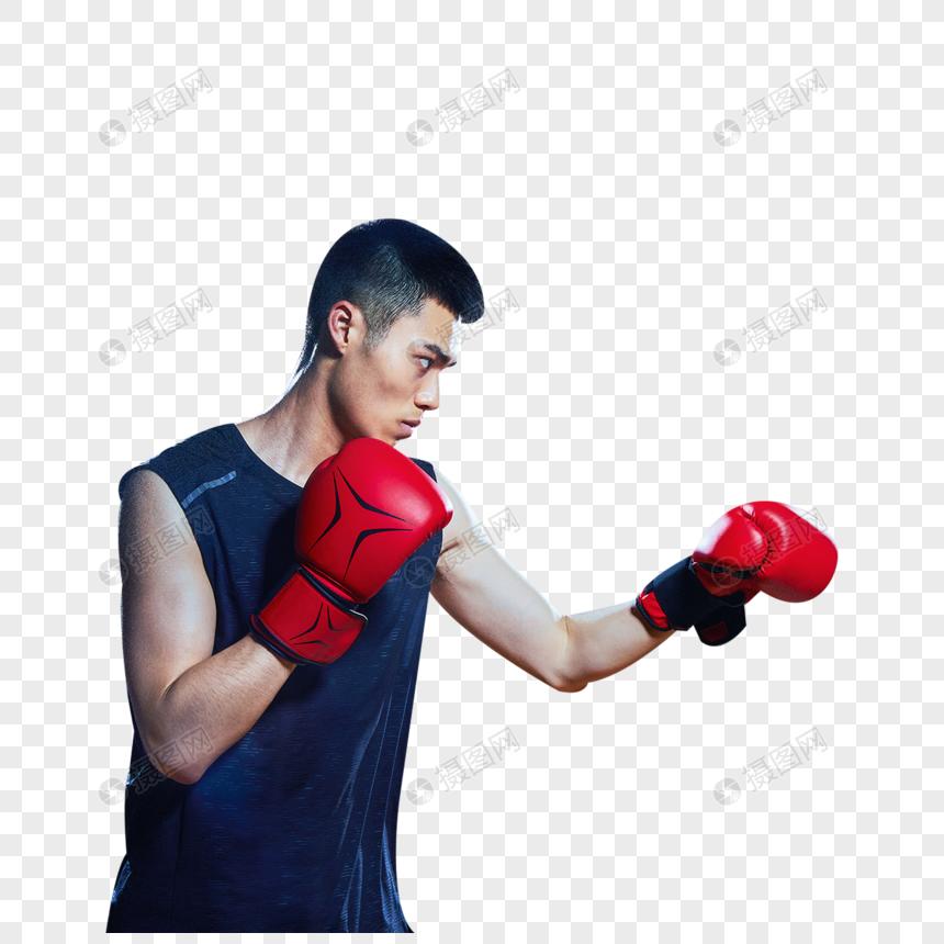 打沙袋的运动男性图片