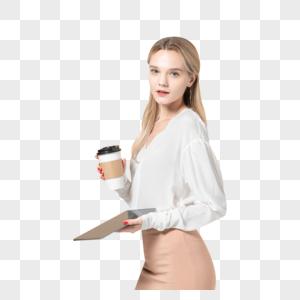 拿着平板电脑和咖啡杯的外国美女图片