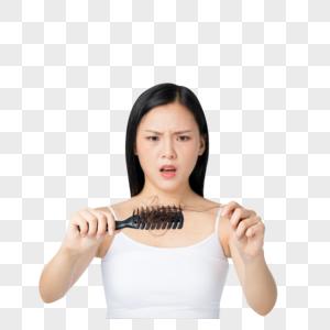 女性梳头烦恼图片