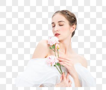 外国优雅女性拿着花朵图片