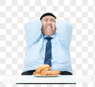 肥胖商务男性吃炸鸡图片