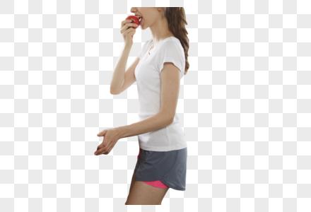 吃新鲜水果的女孩图片