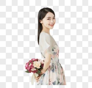 年轻美女手拿手捧花图片
