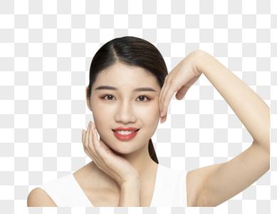 青年女性美容面部手势展示图片