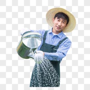 农场园丁提水桶为植物浇水图片